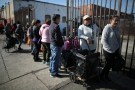 People queue to receive food from the St. Francis Center Food Bank in Los Angeles, California U.S. January 10, 2018. REUTERS/Lucy Nicholson - RC18425A1A90